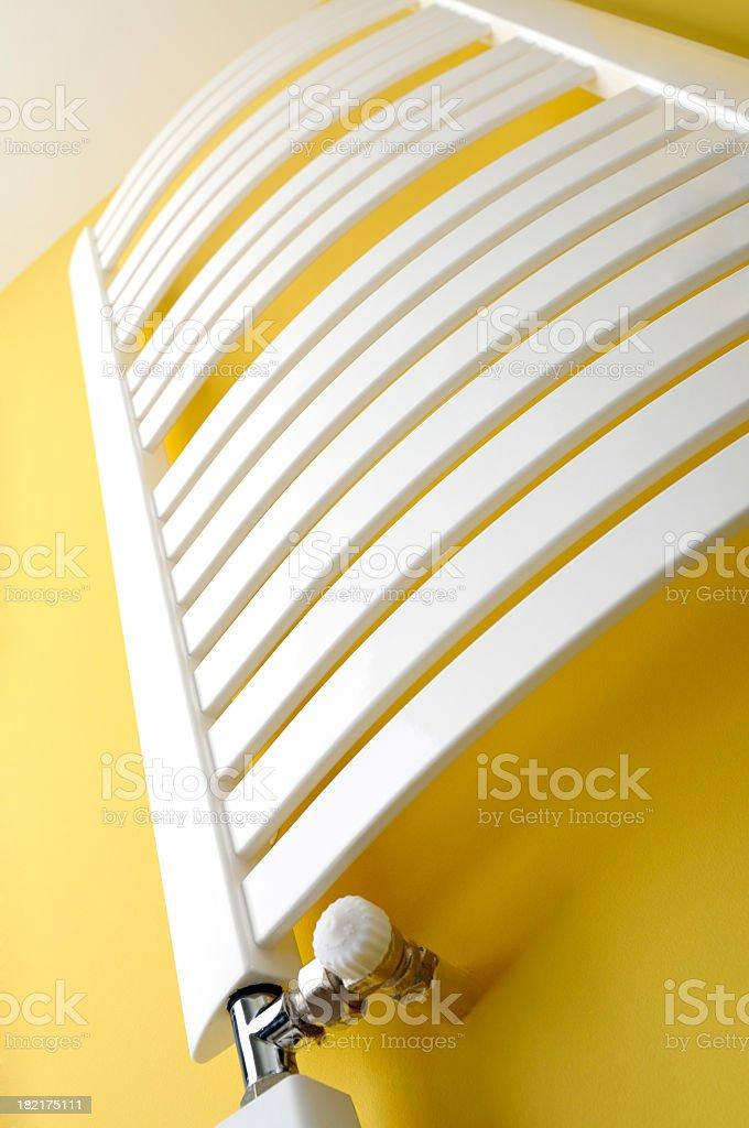 Bathroom heater, towel radiator on yellow wall, frog perspective royalty-free stock photo