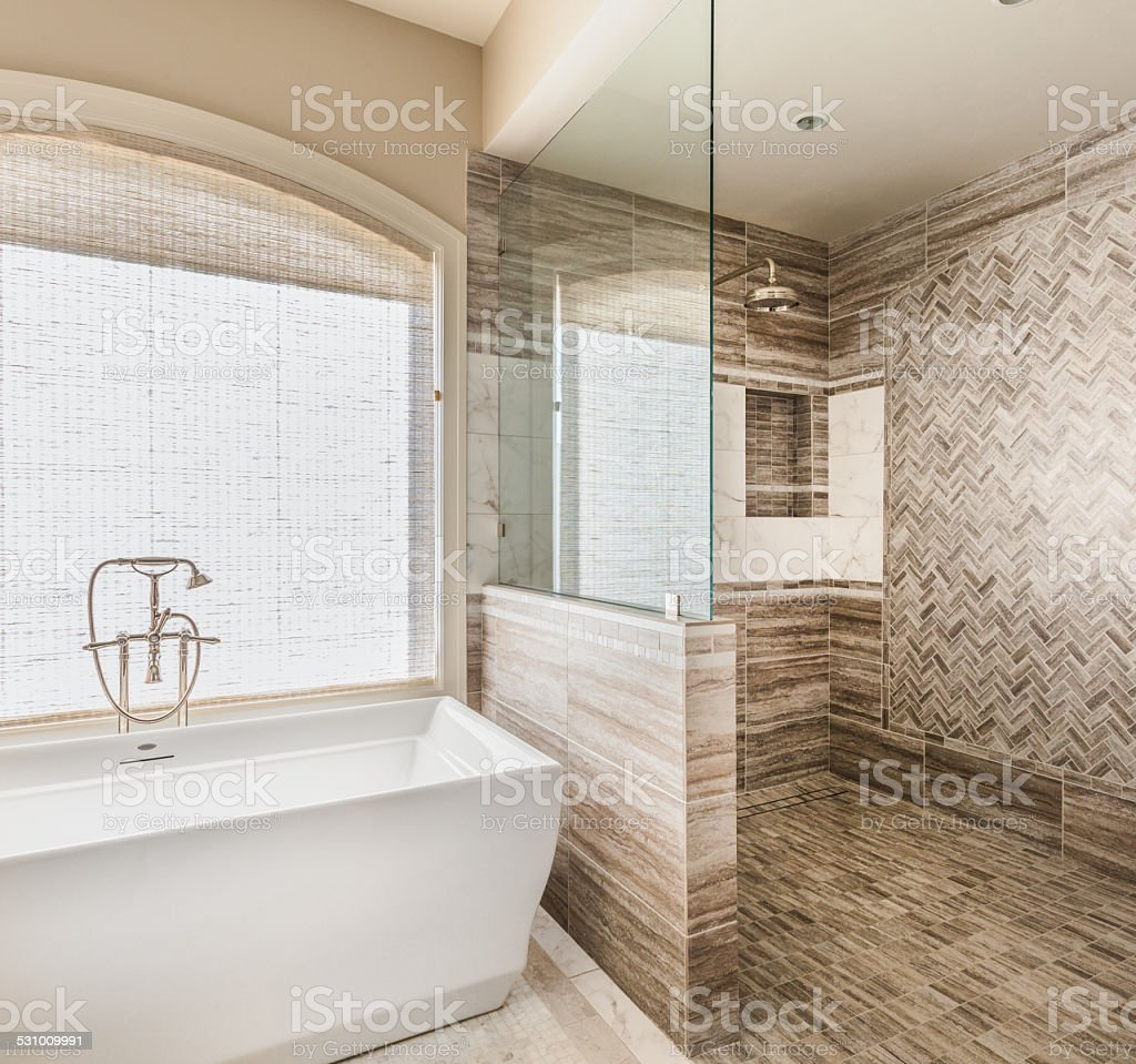 Bathroom in Luxury Home: Bathtub and Shower stock photo