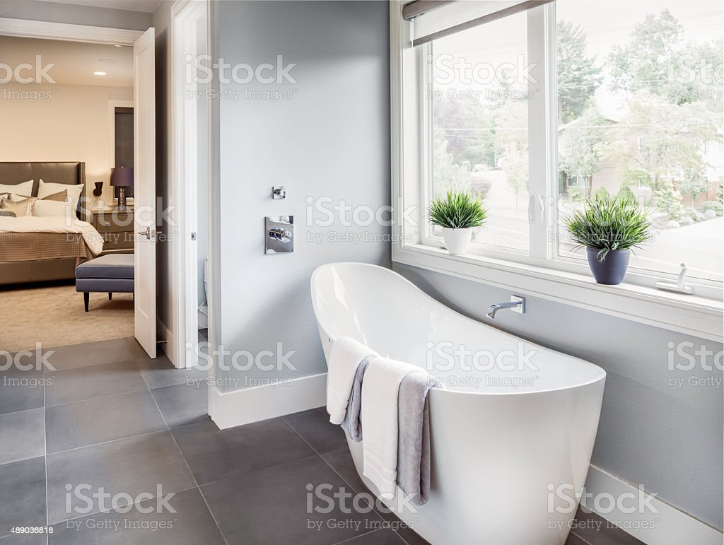 Bathroom in Luxury Home: Bathtub with View of Master Bedroom stock photo