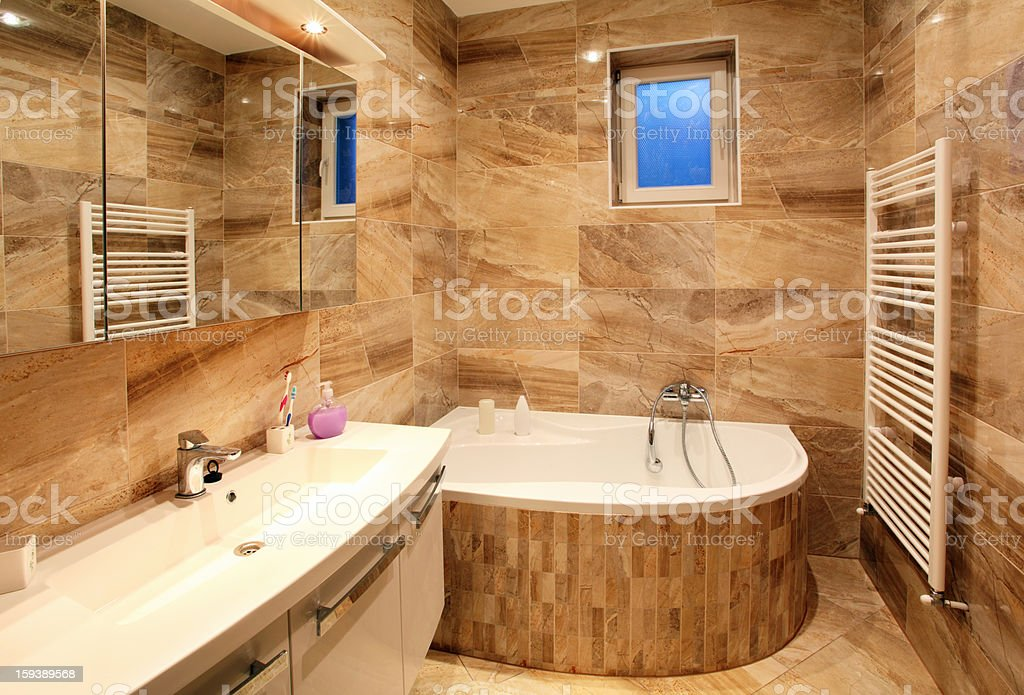 bathroom in luxury home with bath and furniture royalty-free stock photo