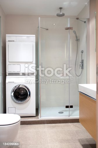 Bathroom in washing machine stock photo 134099064 istock for Washing machine in bathroom ideas