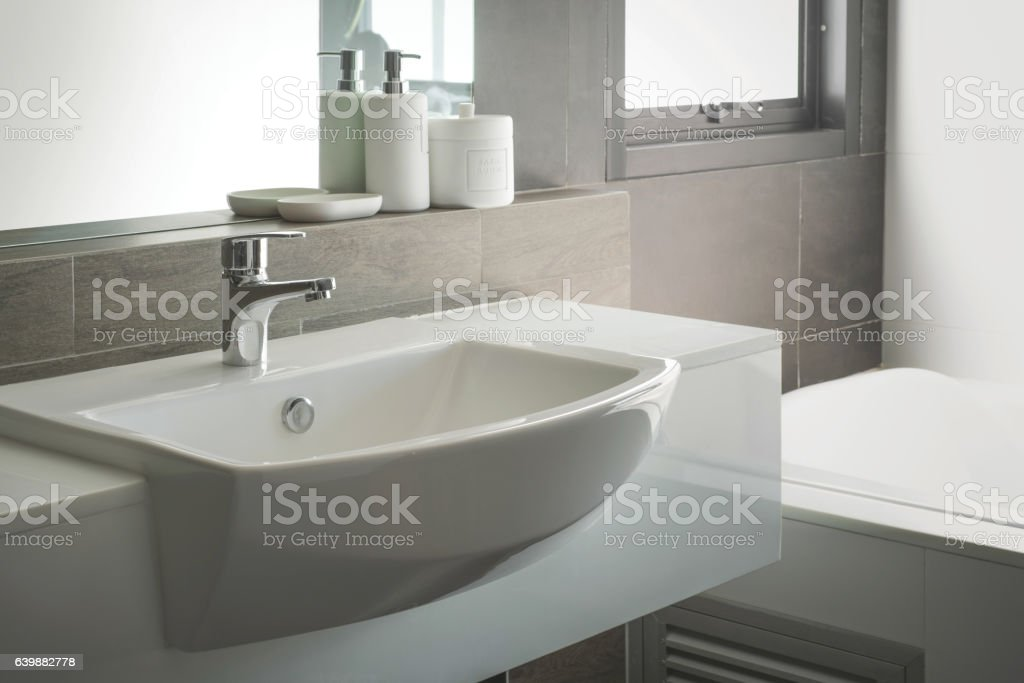 Bathroom interior with sink and faucet stock photo