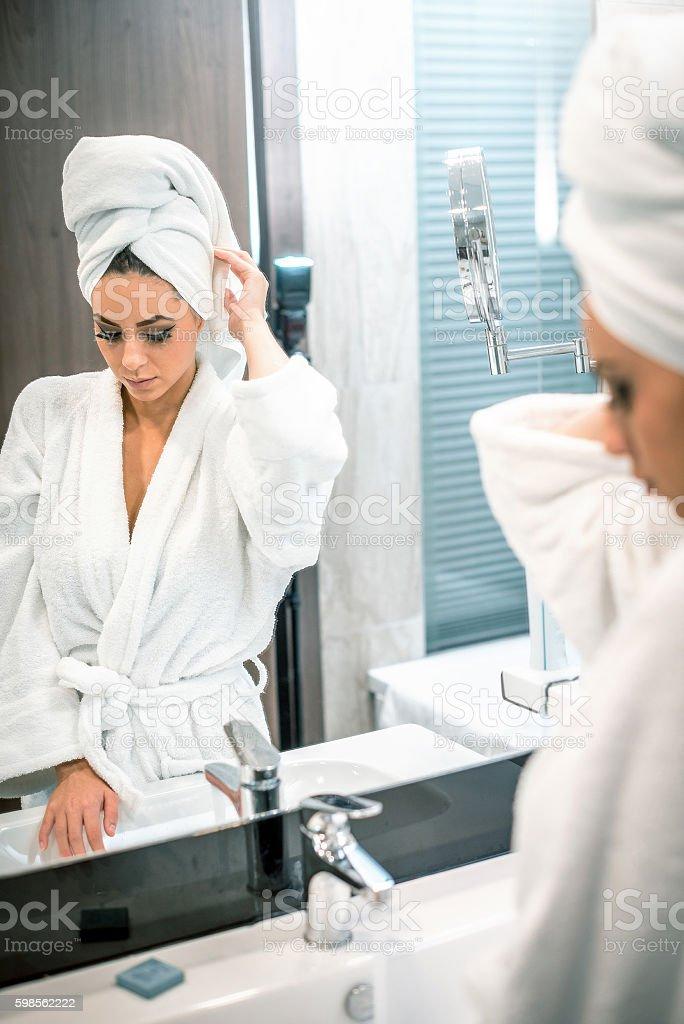 Bathroom mirror girl stock photo