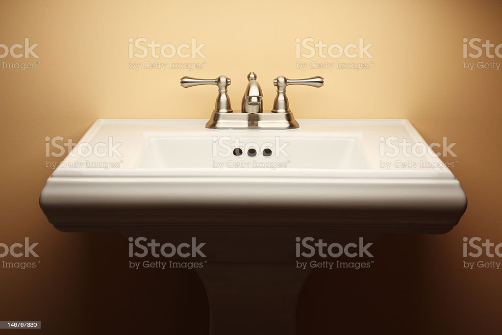 Bathroom Pedestal Sink with Brushed Nickel Faucet stock photo
