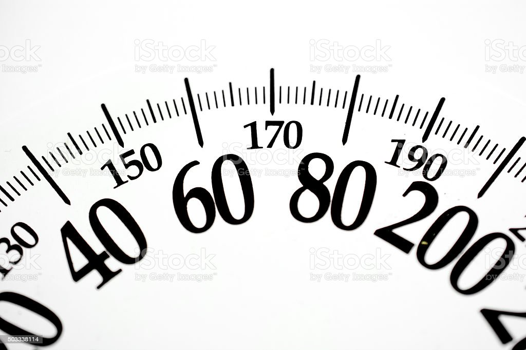 Bathroom scale numbers showing weight in pounds and kilograms stock photo