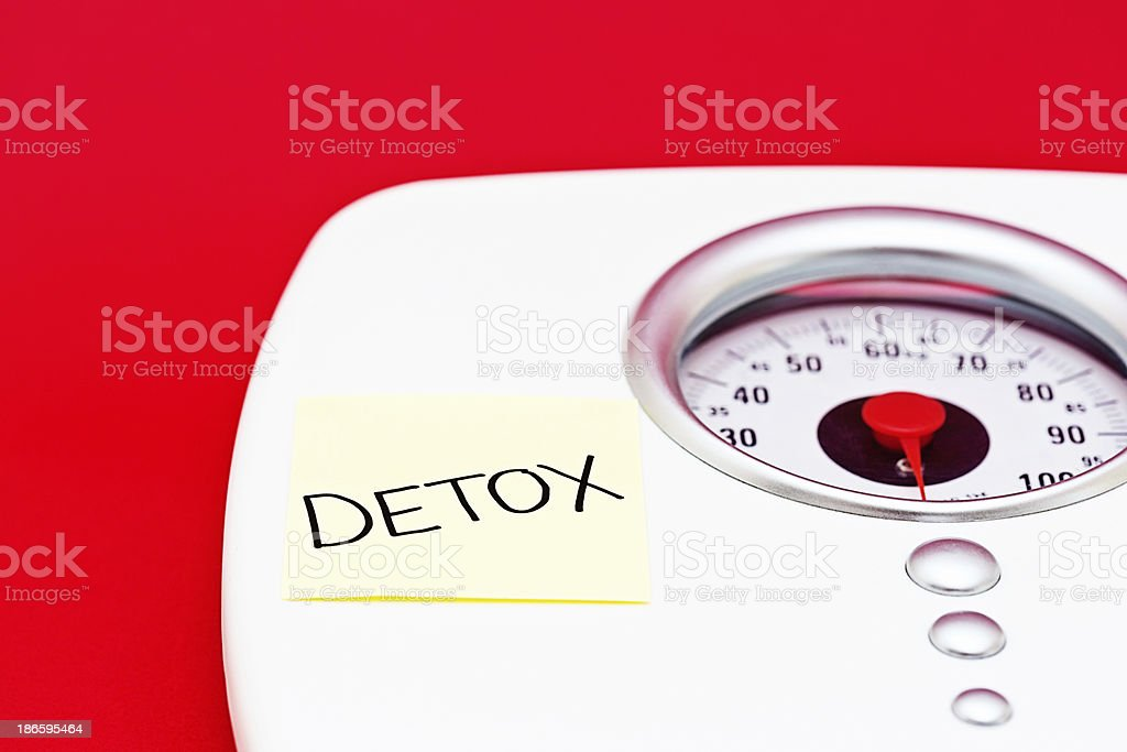 Bathroom scale reminder that after overindulgence, you need to DETOX. royalty-free stock photo