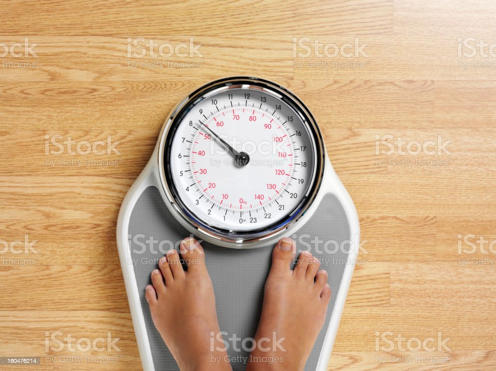 Bathroom Scales and Feet stock photo
