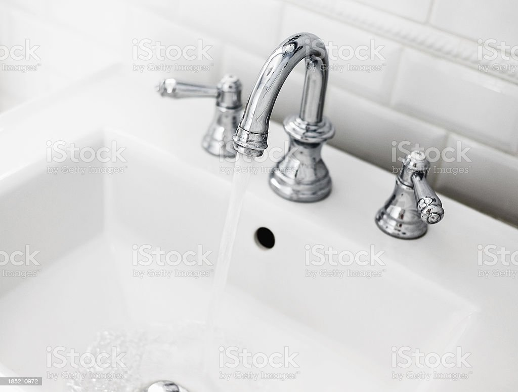 Bathroom sink and faucet stock photo