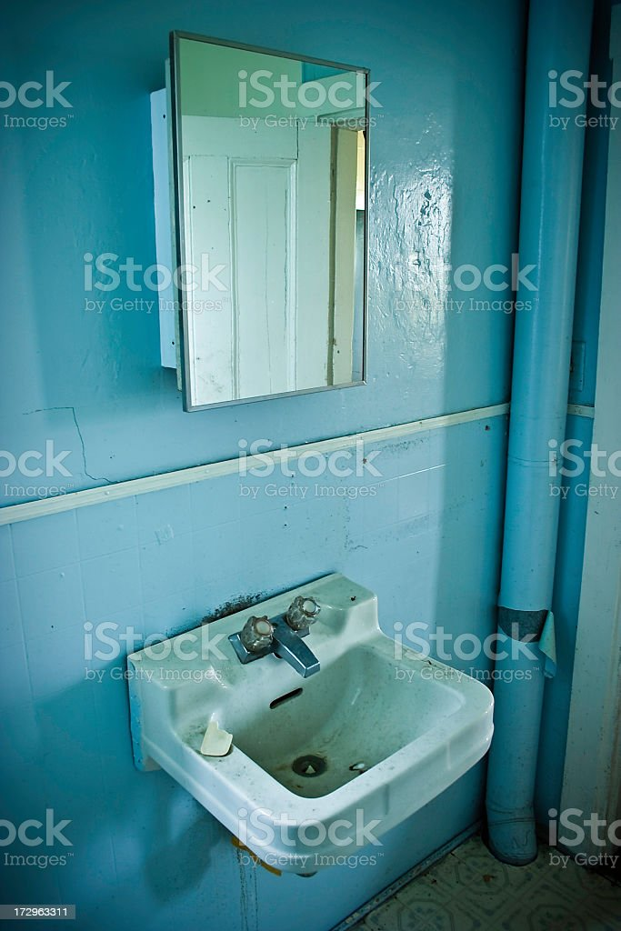 Bathroom Sink and Mirror in Abandoned Home royalty-free stock photo