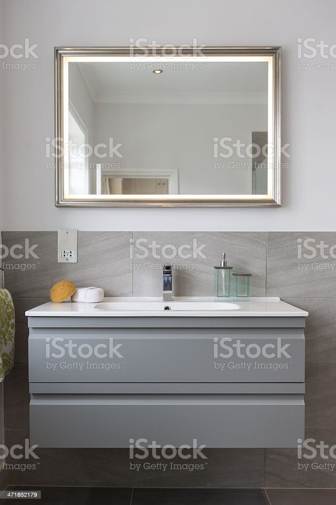 Bathroom Sink and Mirror with Hand towel & Sponge stock photo