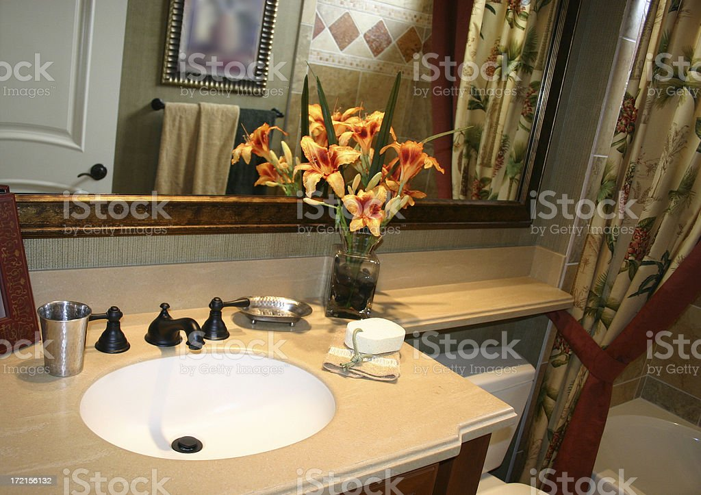 Bathroom Sink with Flowers royalty-free stock photo
