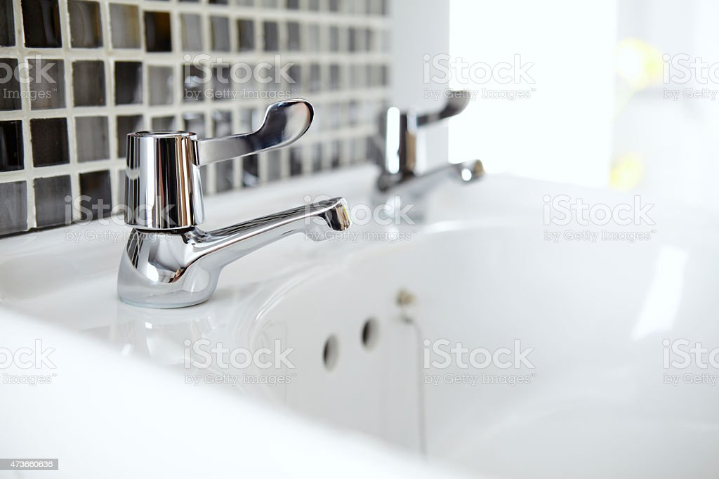 Bathroom sink with two tap stock photo
