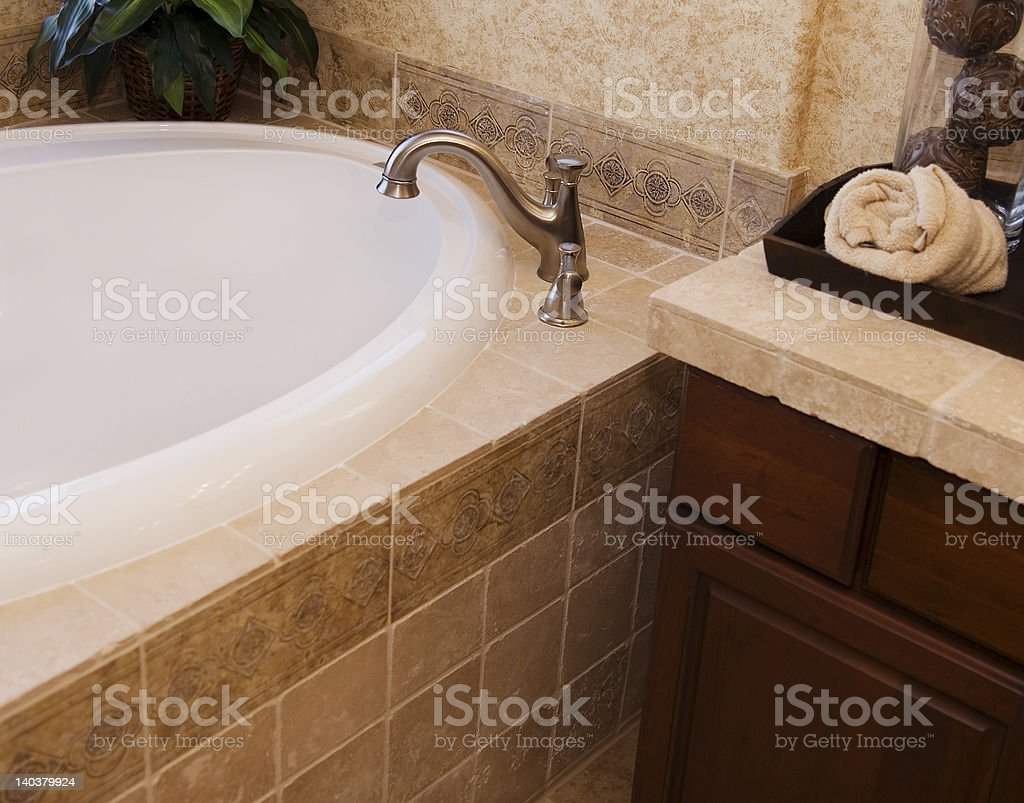 Bathroom tile and Faucet royalty-free stock photo