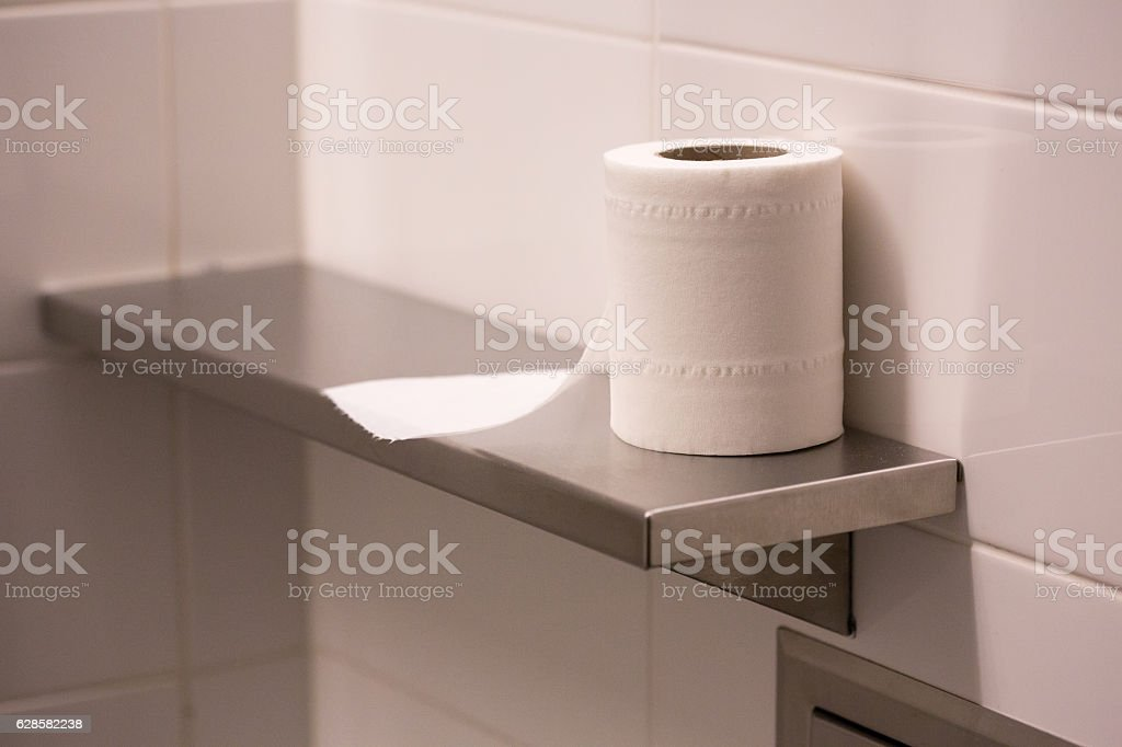 bathroom tissue on shelf stock photo