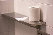 bathroom tissue on shelf