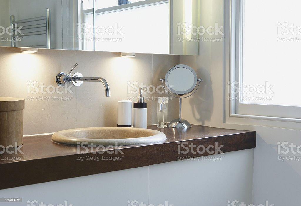 Bathroom vanity beside window stock photo