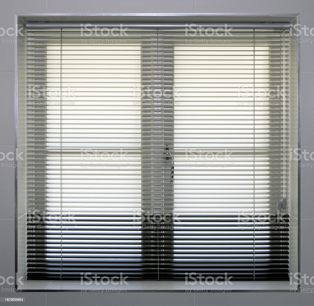 Bathroom window with Venetian blinds royalty-free stock photo
