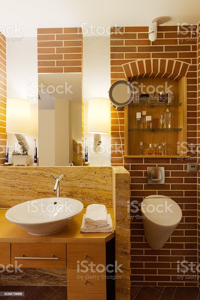 Bathroom with brick wall stock photo