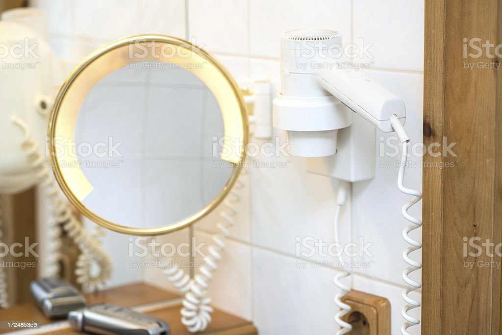 bathroom with mirror and hair dryer royalty-free stock photo