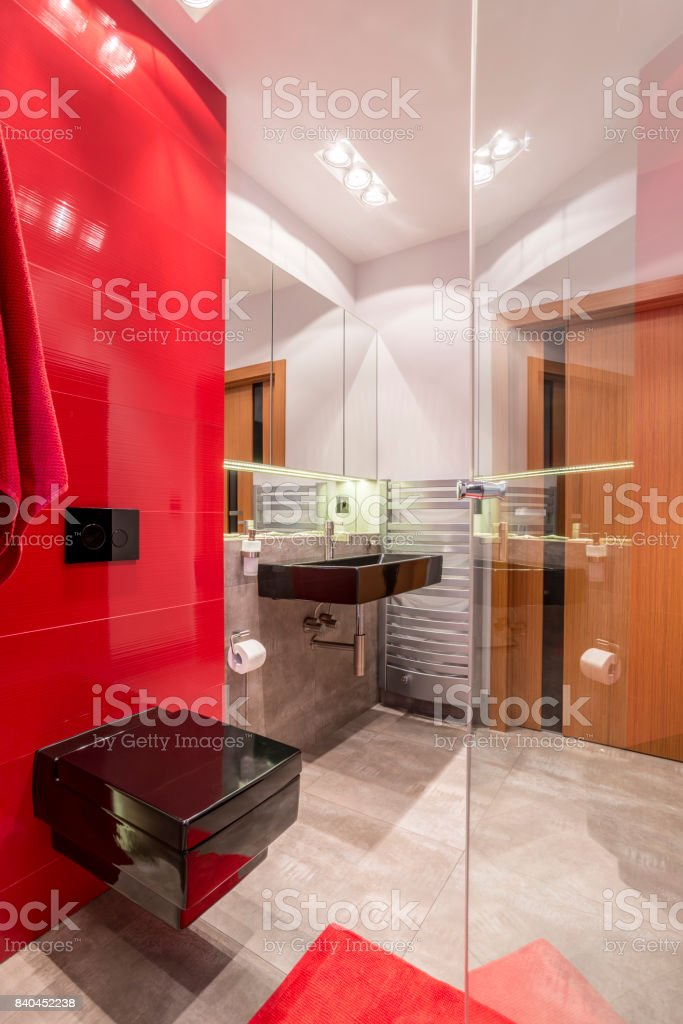 Bathroom with red elements stock photo