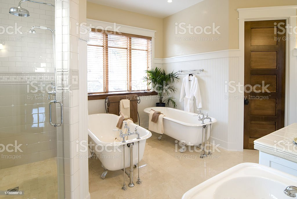 Bathroom with two claw bathtubs stock photo