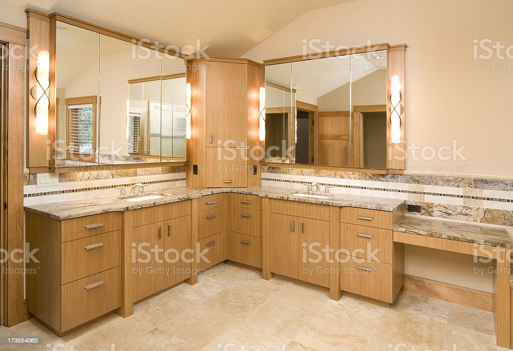 Bathroom with two sinks and vanity mirrors stock photo