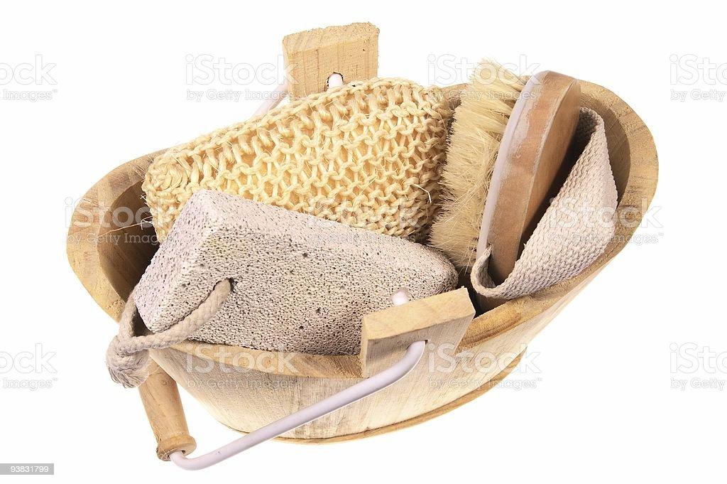 bathroom wooden bucket with pumice sponge nad brush stock photo