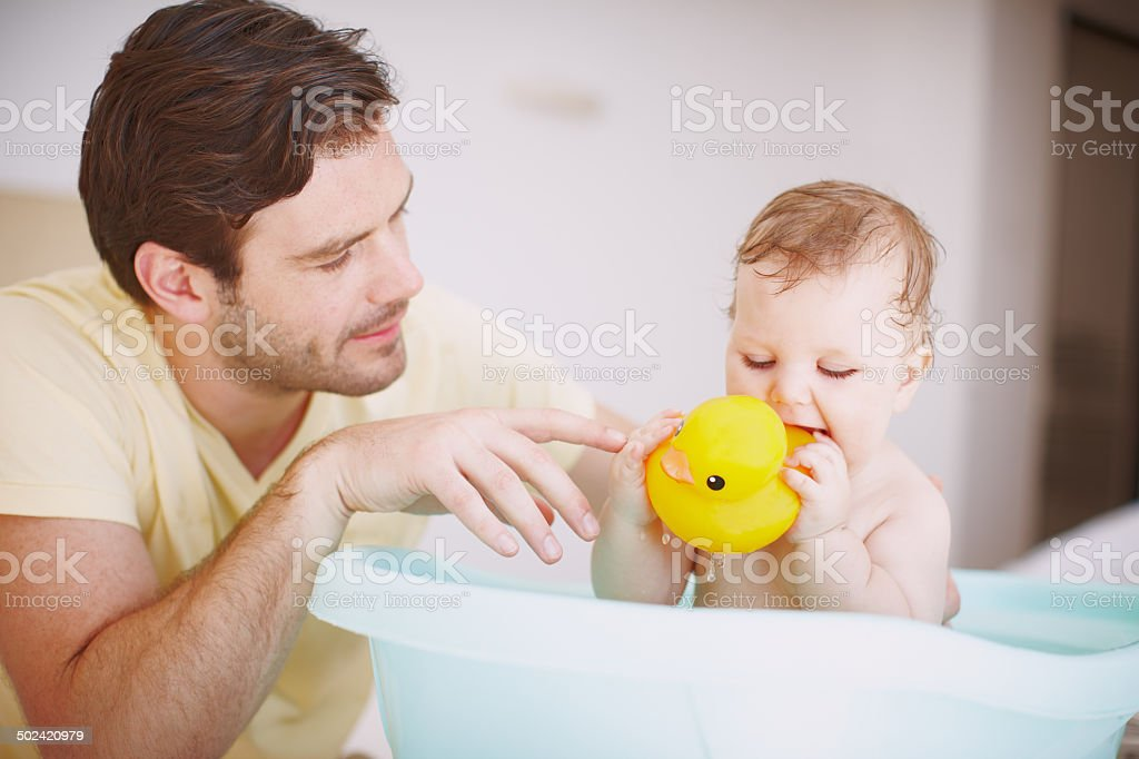 Bathtime with Dad and Mr Duck stock photo
