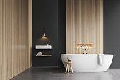 Bathtub, a sink and a chair