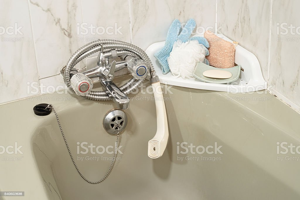 bathtub details tap faucet sponge drain plug and soap stock photo