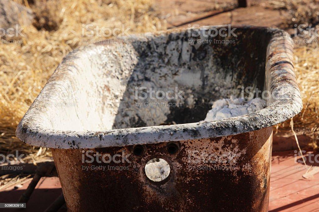 Bathtub Rusted Claw Foot Bathroom Fixture stock photo
