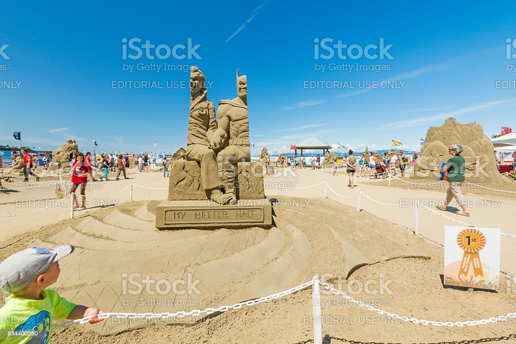 Batman and Joker sand sculpture stock photo