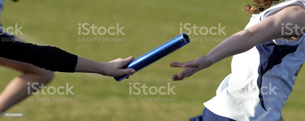 Baton handoff stock photo