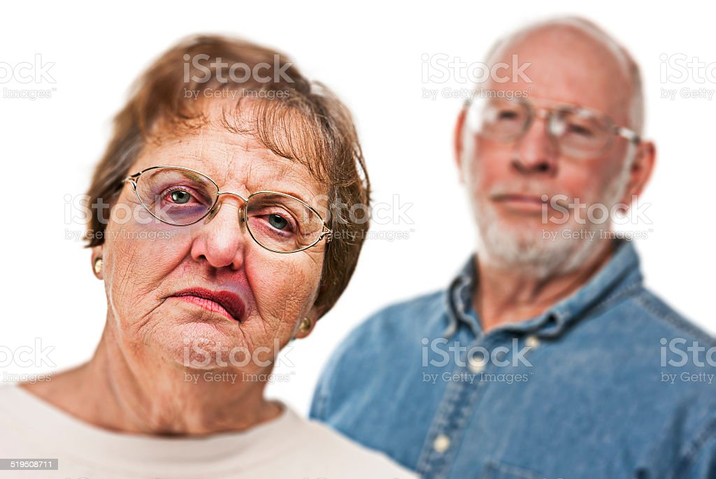Battered and Scared Woman with Ominous Man Behind stock photo
