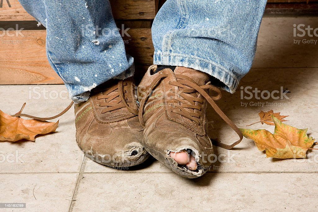 Battered shoes stock photo
