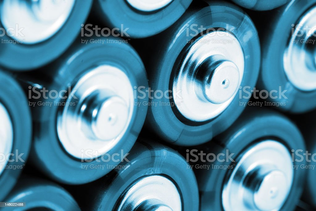 AA batteries in cold blue royalty-free stock photo
