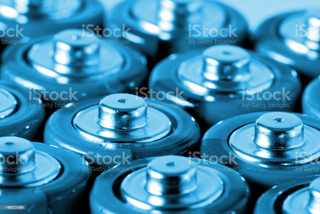 AA batteries in cold blue stock photo