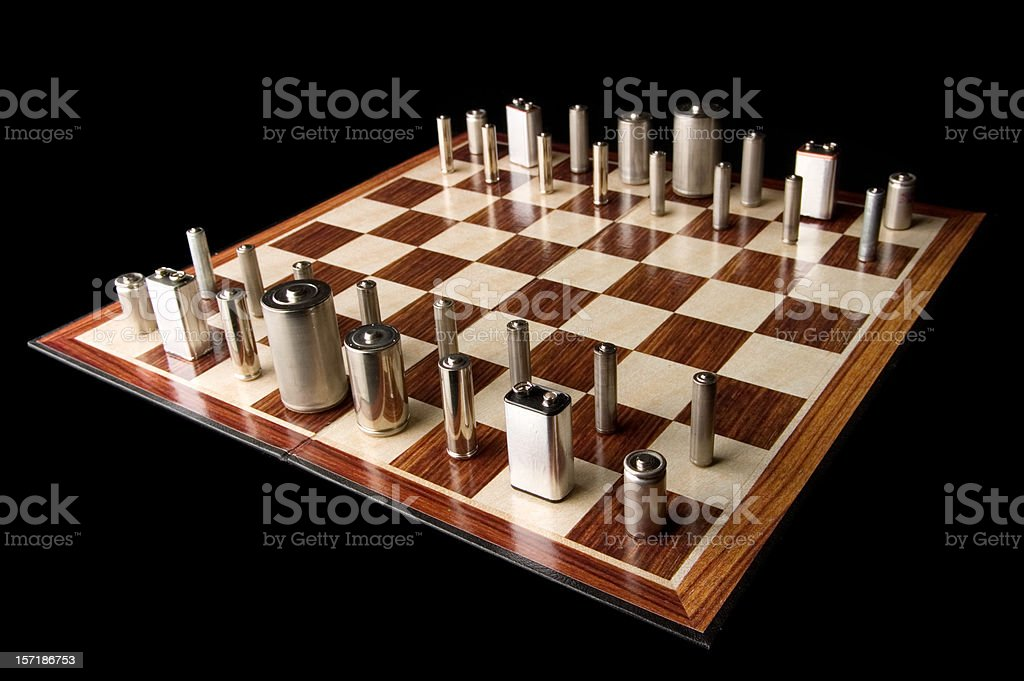 Batteries on Chess Board stock photo