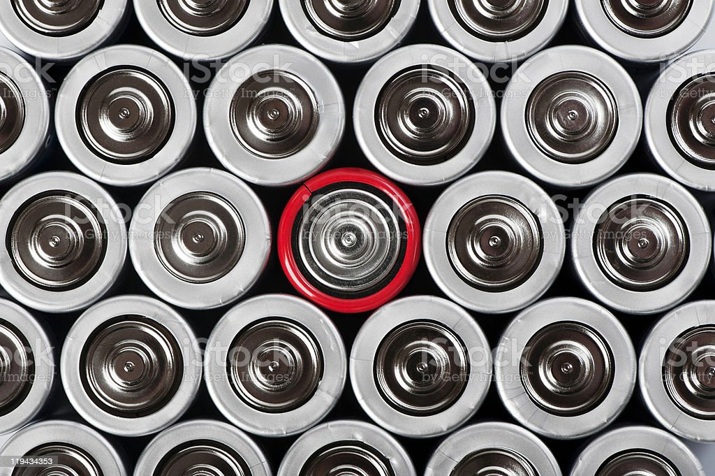 batteries set with contrast red one in the middle royalty-free stock photo