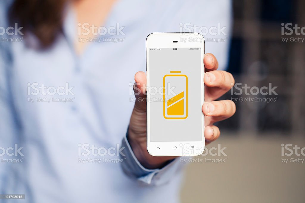Battery concept. Hand showing mobile phone. stock photo