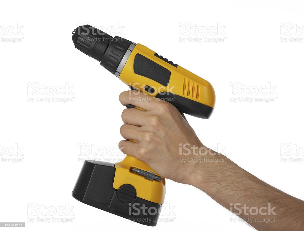 Battery drill in left hand royalty-free stock photo
