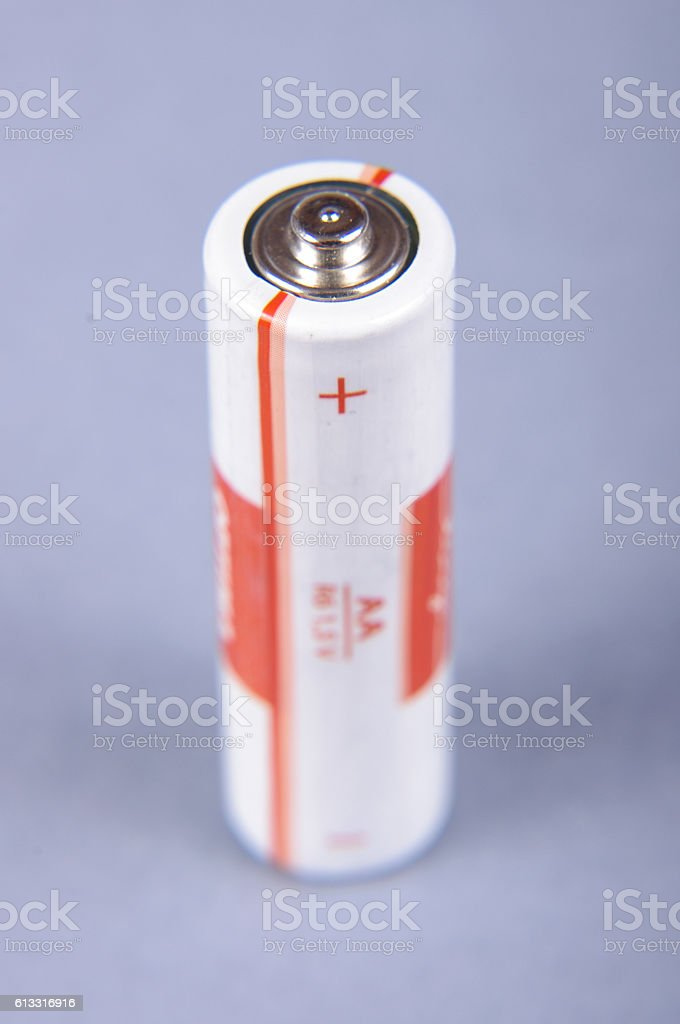Battery isolated on the gray background stock photo