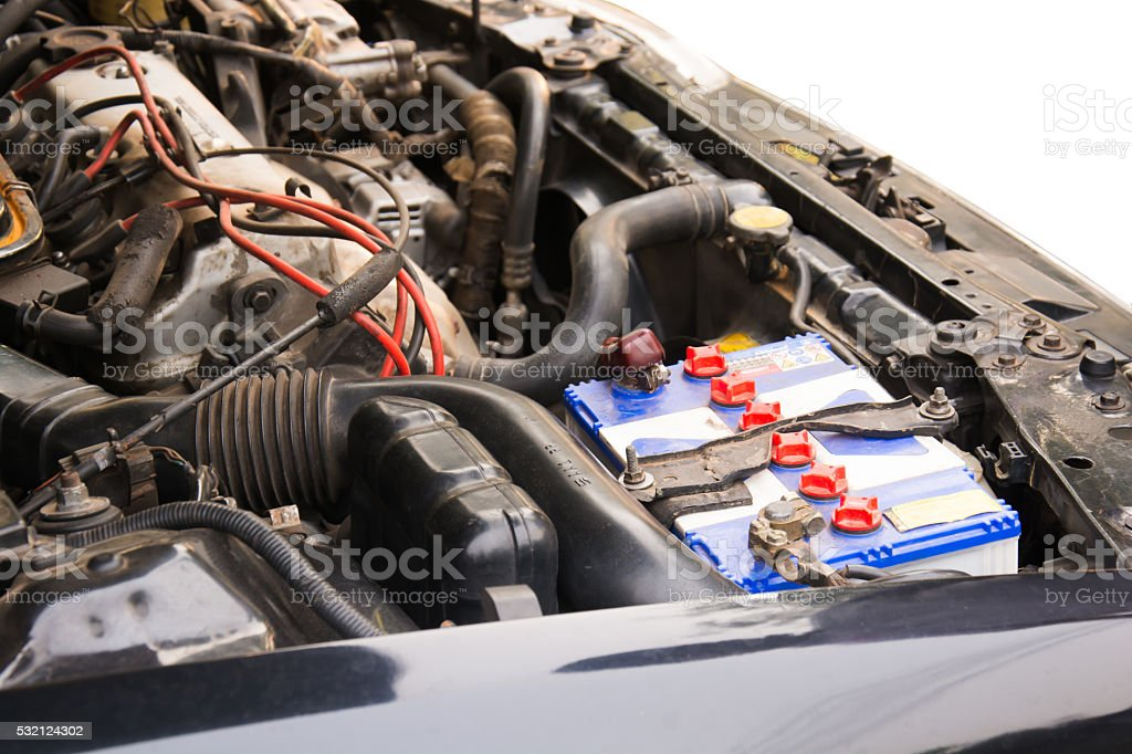 battery of a car on white stock photo