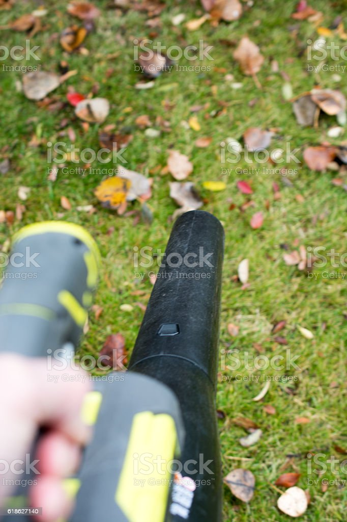 Battery powered leaf blower handheld and in use stock photo