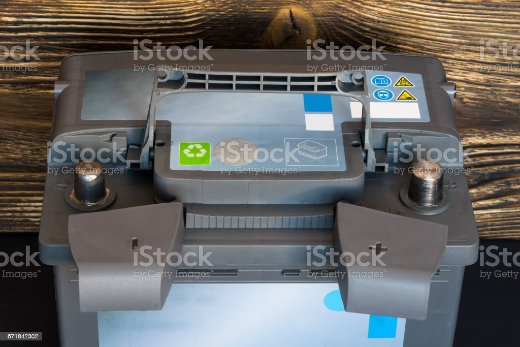 Battery stands on a wooden board and ready to go stock photo