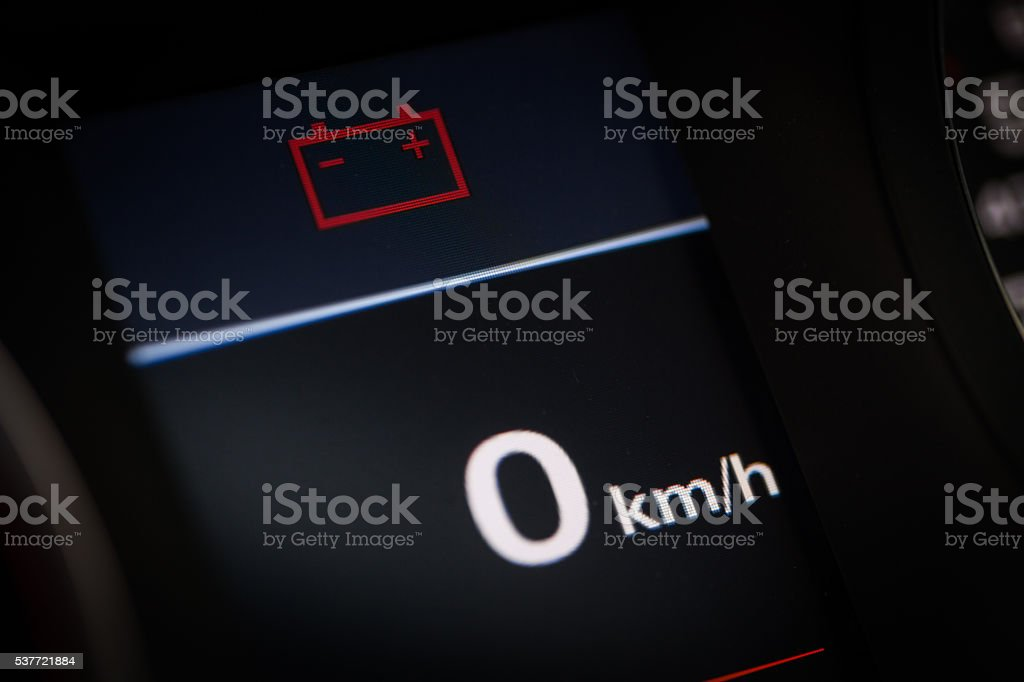 Battery symbol in a car stock photo
