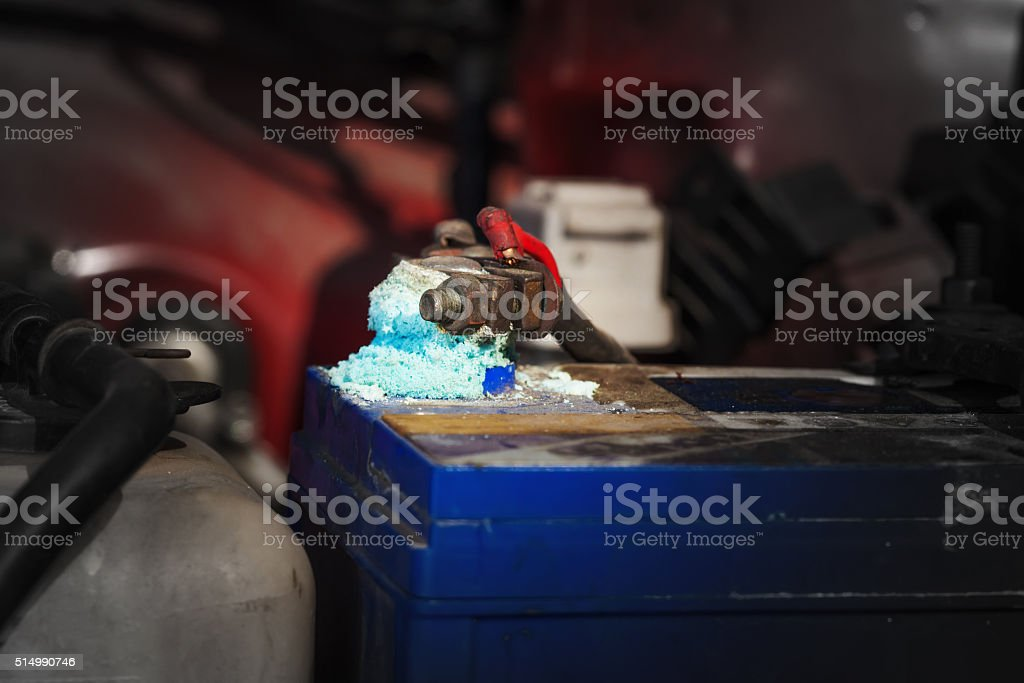 Battery terminals corrode, visible in the form of white powder. stock photo