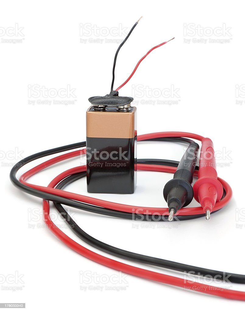 Battery with wires and probes for the measurement. royalty-free stock photo