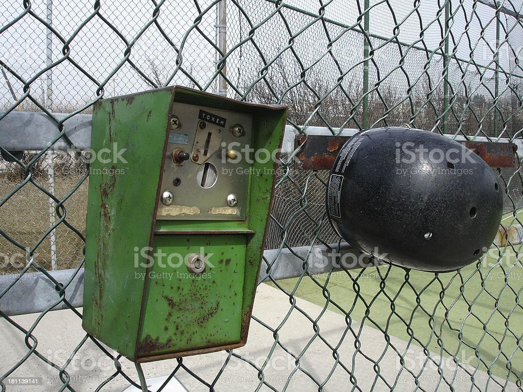 Batting cage token box with helment stock photo