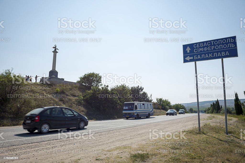 Battle of Balaclava monument and cars on road in Crimea stock photo